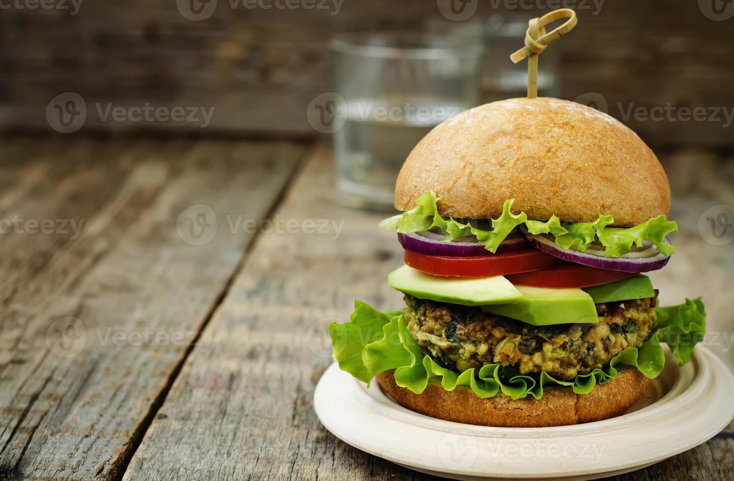 spicy vegan curry burgers with millet, chickpeas and herbs photo