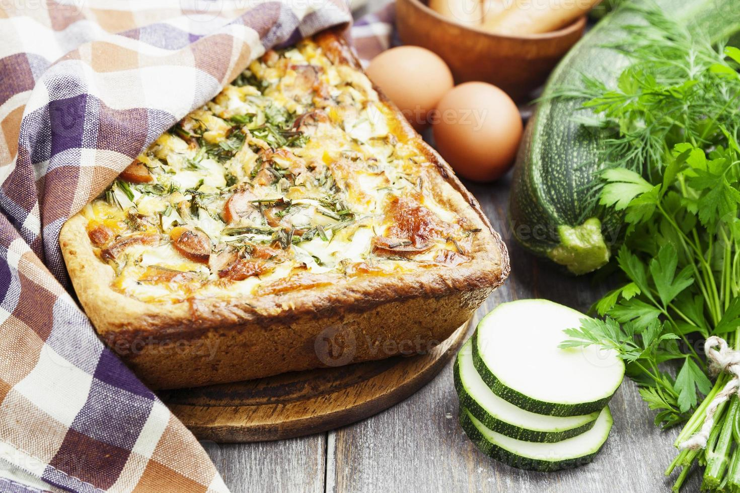 Pie with zucchini, sausage and herbs photo