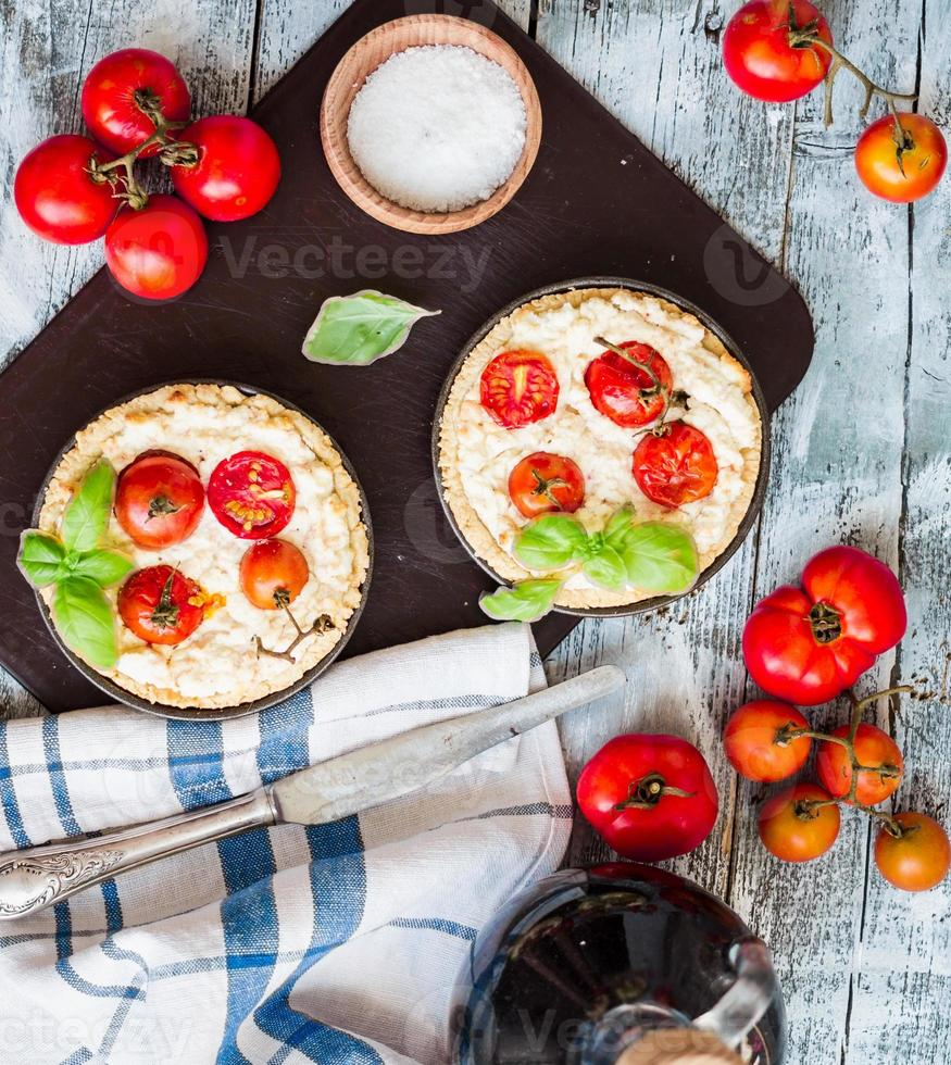quiche with goat cheese, cherry tomatoes and basil photo