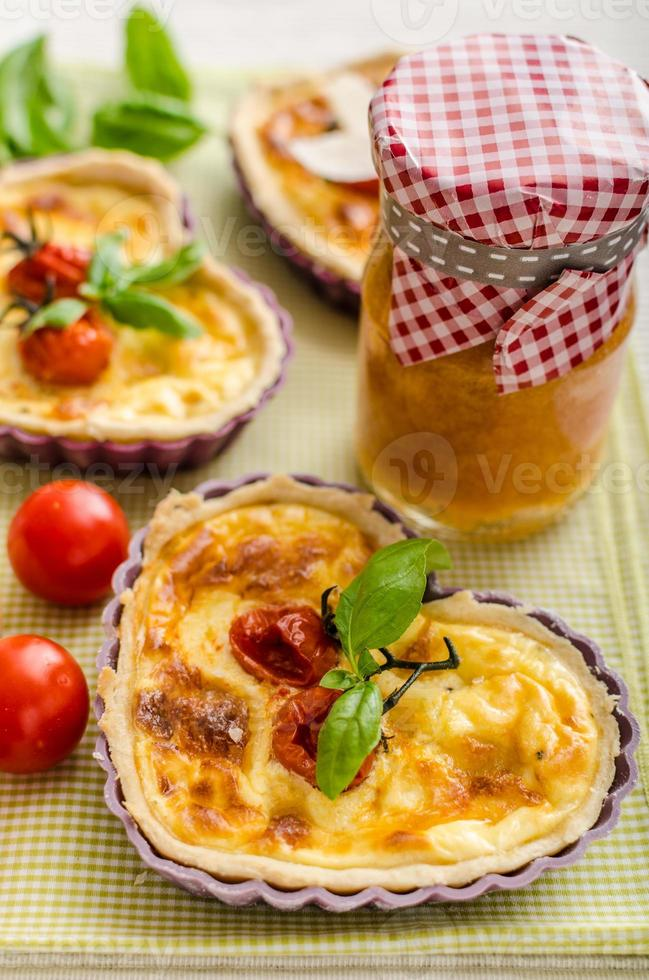 Quiche with cheese and cherry tomatoes photo