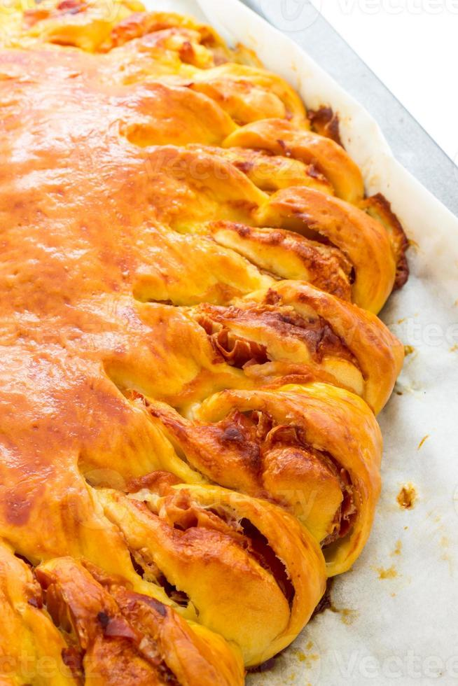Savory pie with bacon and soft cheese photo