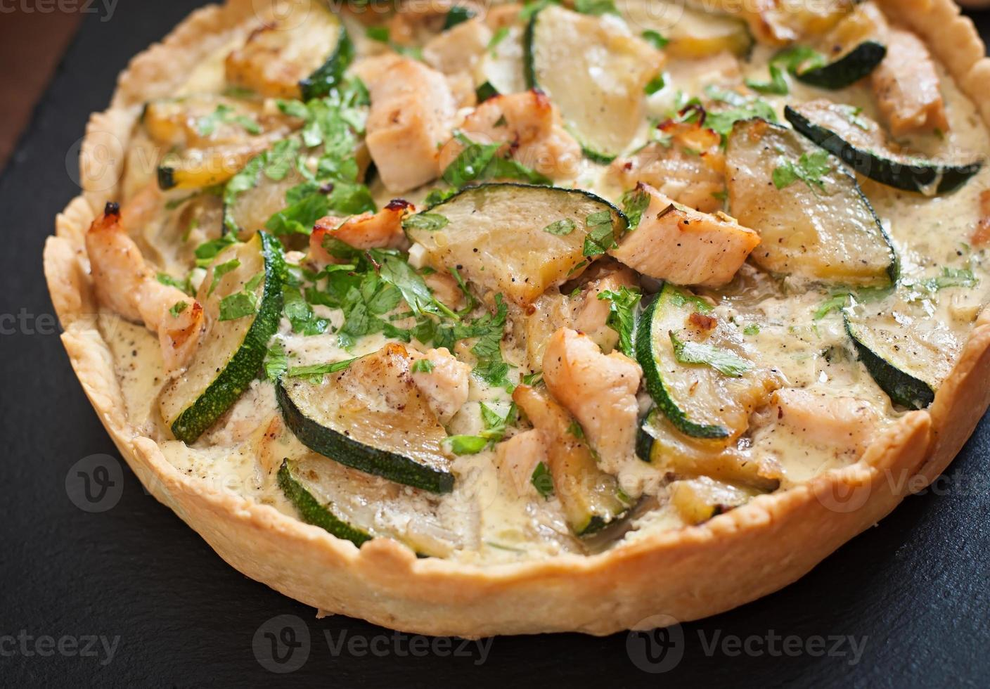 Quiche with chicken and zucchini with herbs photo