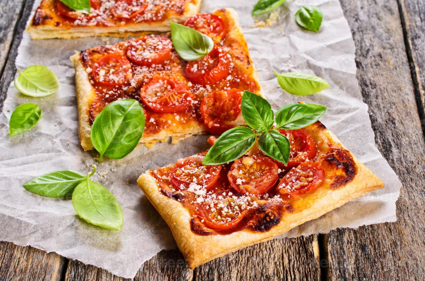 Pie with tomatoes, cheese and Basil photo