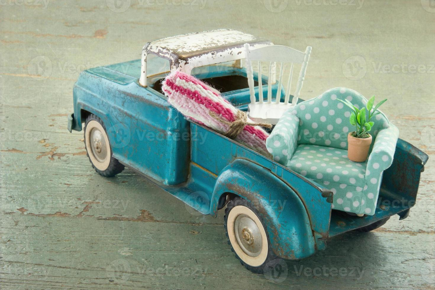 Old vintage toy truck on wooden background photo