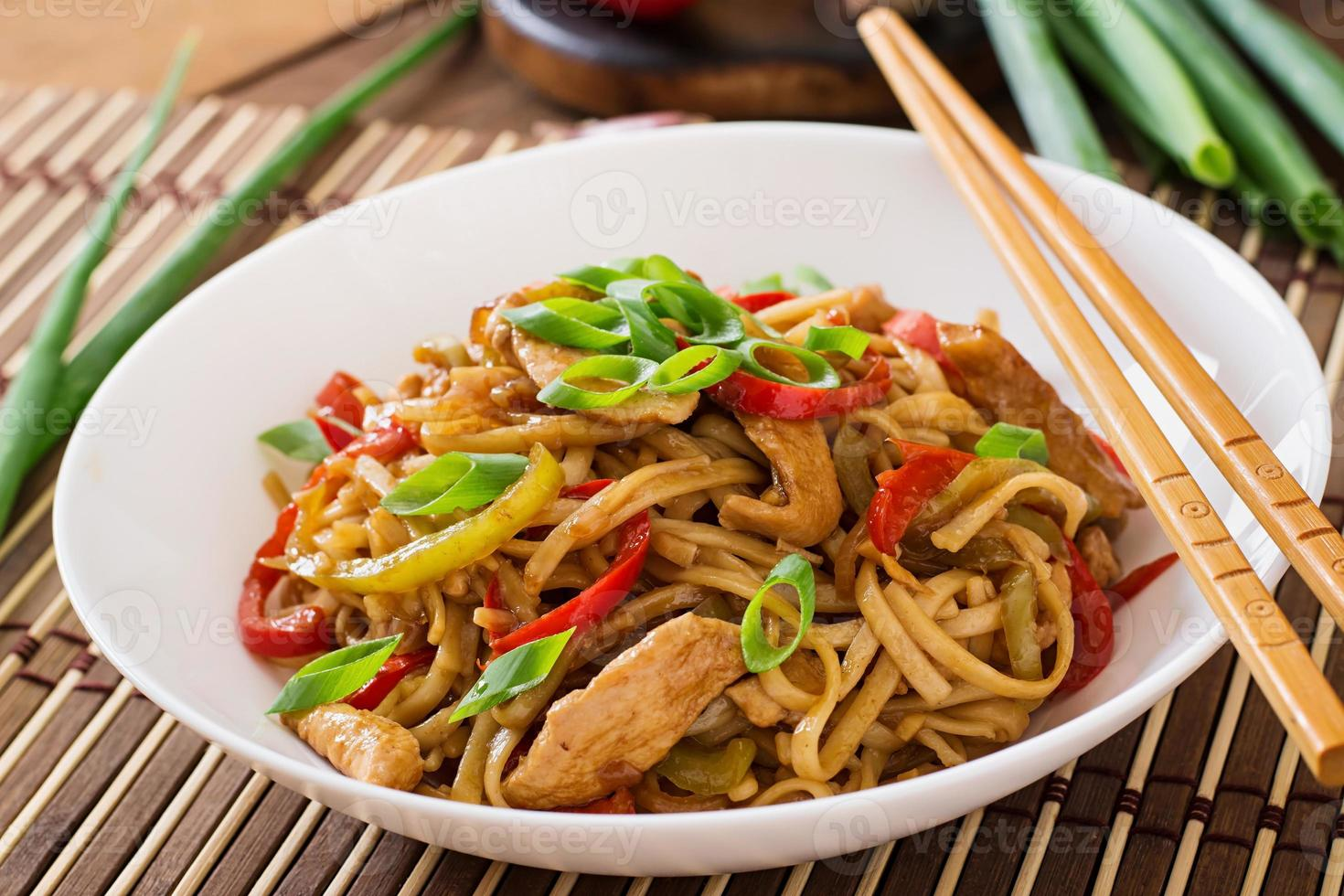 Udon noodles with chicken and peppers - Japanese cuisine photo