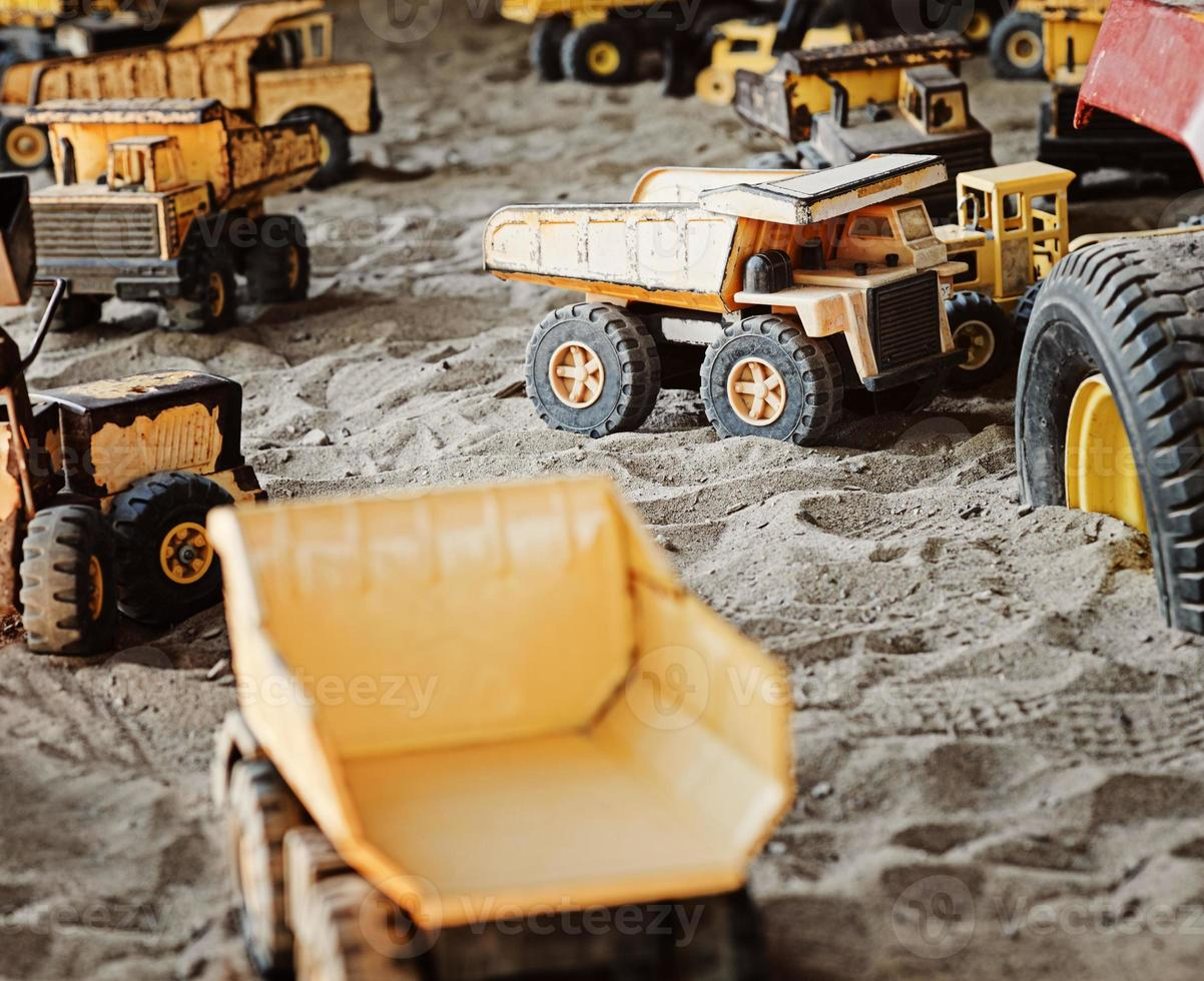 Old, Rusted Construction Toys in Sandbox photo