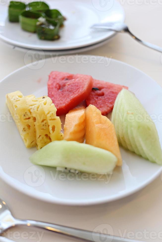 Mixed fruits in white dish. photo