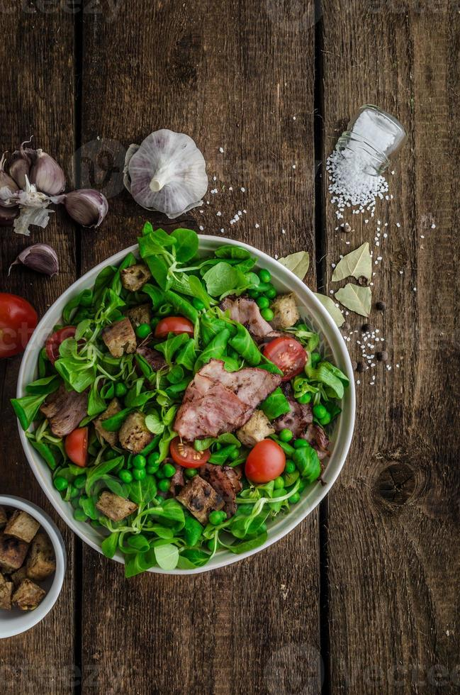 Fresh salad with bacon and croutons photo