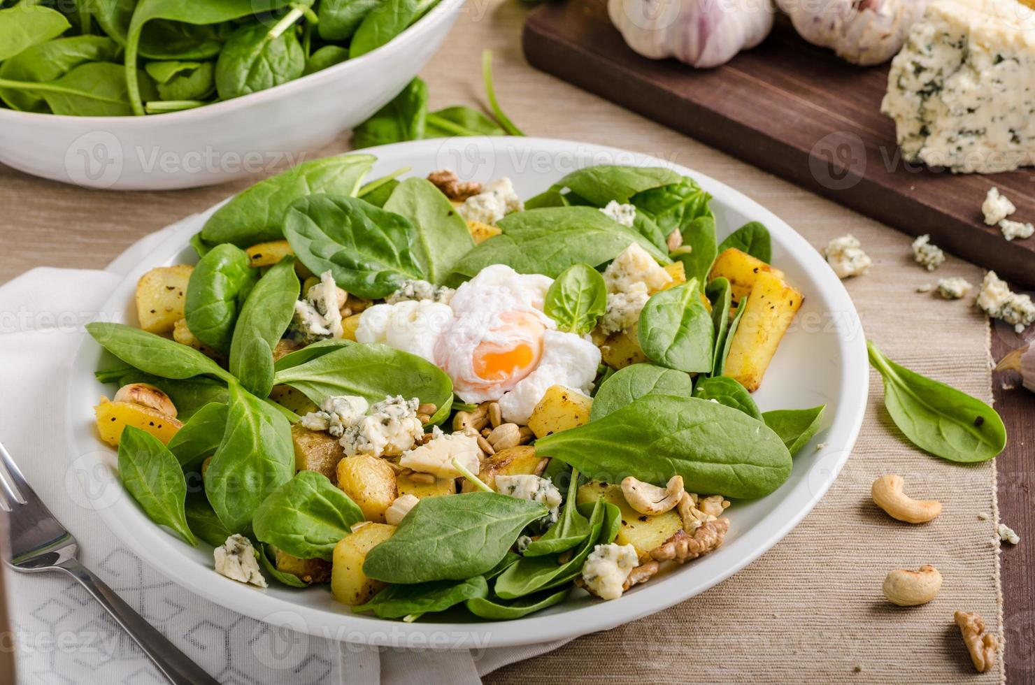 Spinach salad with egg benedict photo