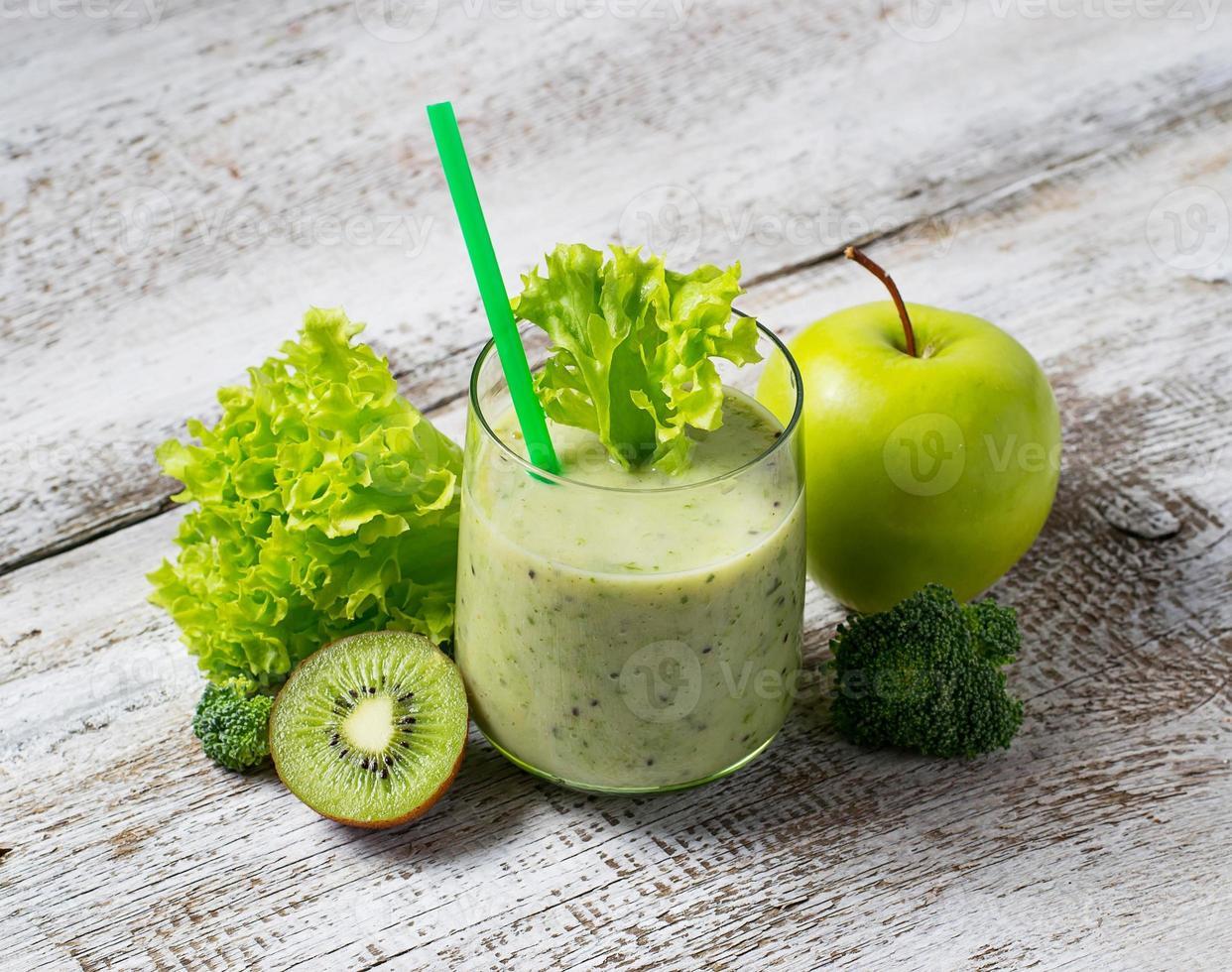 Green smoothie with kiwi, apple, salad and broccoli, healthy dri photo