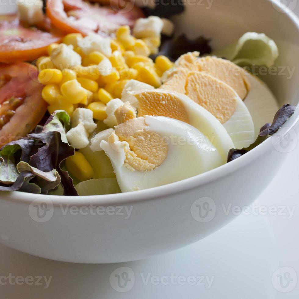 salad with eggs with corns and tomatoes photo