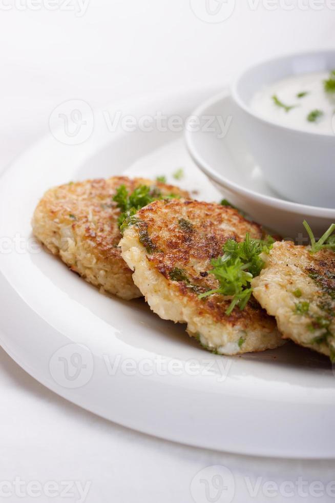 Cabbage pancakes with parsley and yogurt dressing photo