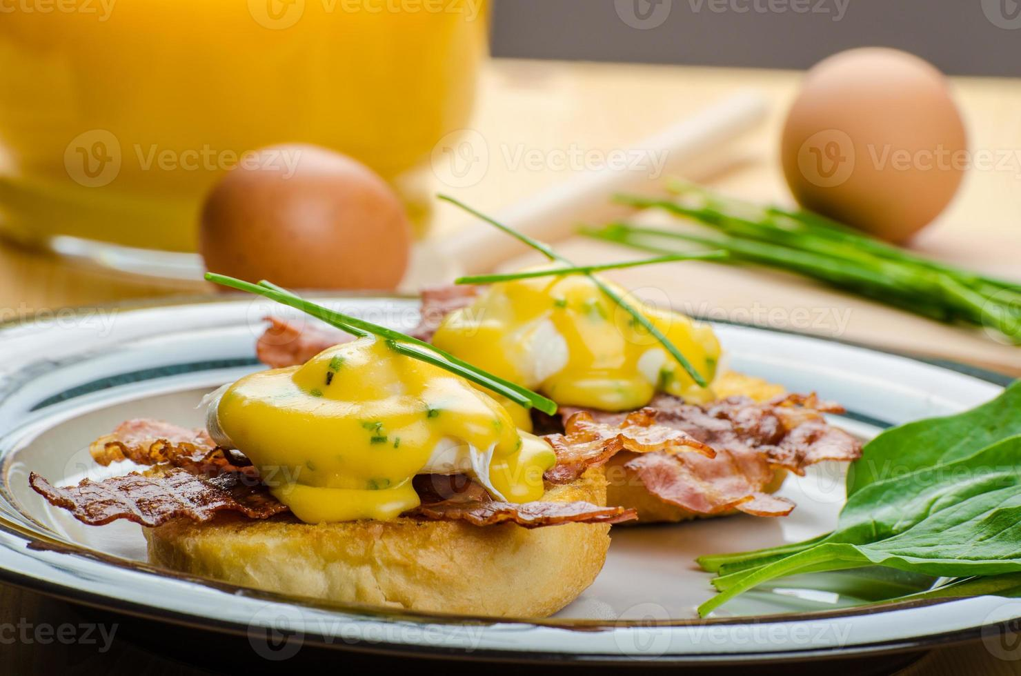 Eggs bvenedict with chives photo