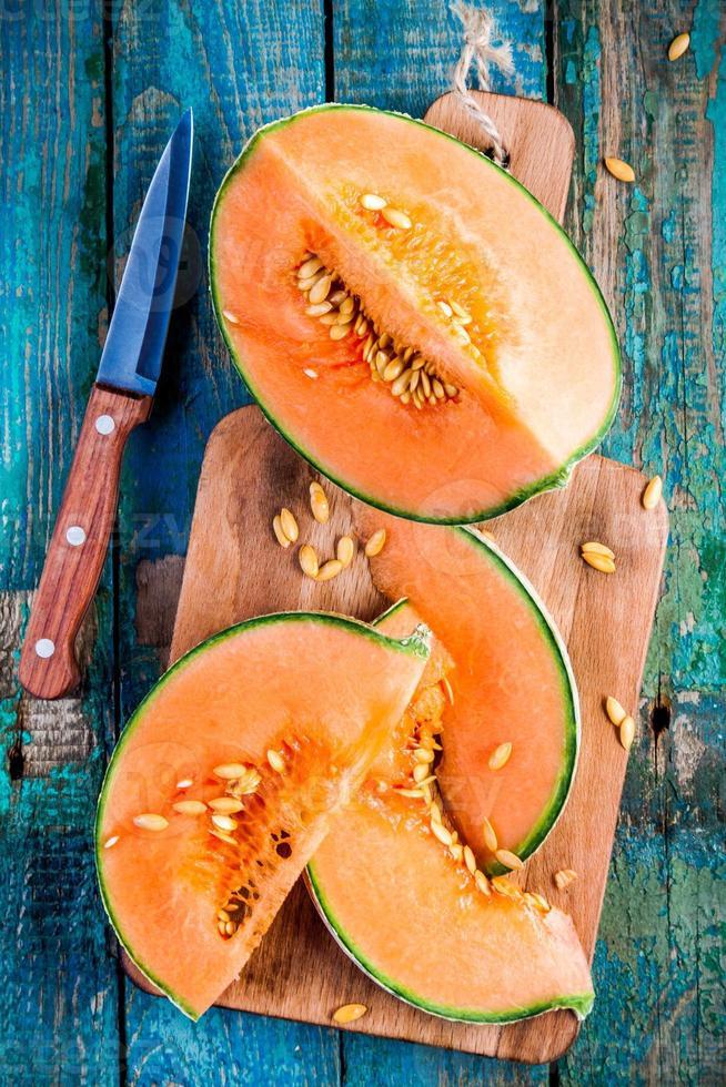 sliced ripe melon on a cutting board photo