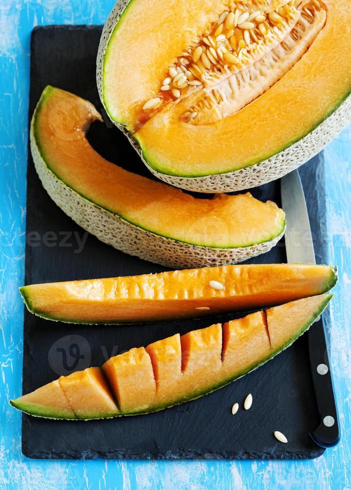 Cantaloupe melon slices. Top view photo