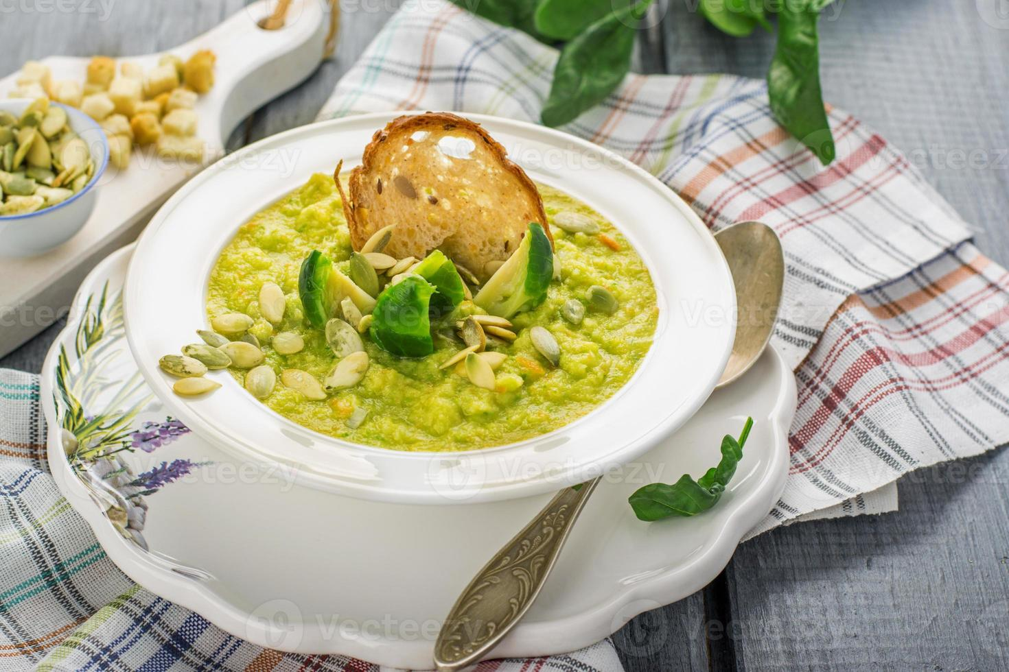 Thick vegetable soup puree with Brussels sprouts, croutons, pumpkin seeds photo