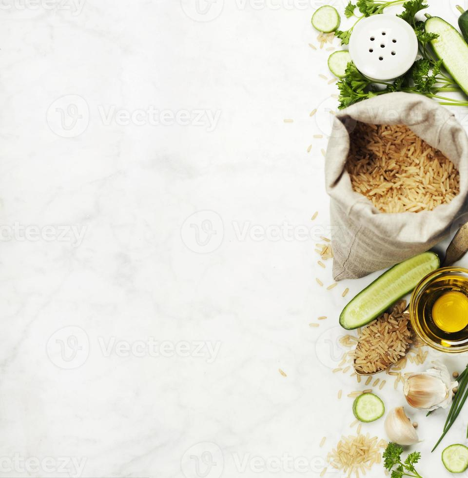 Brown rice and raw fresh vegetables photo