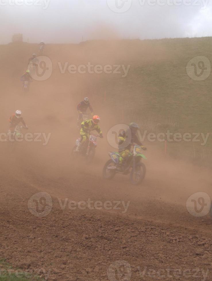 Dusty motocross riders photo