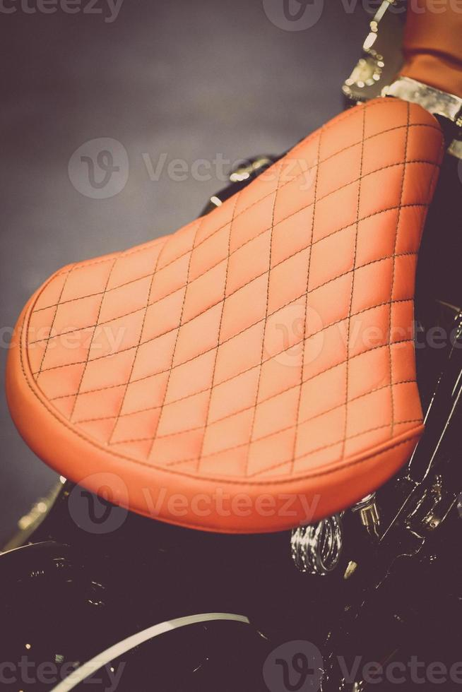 Vintage motorcycle saddle photo
