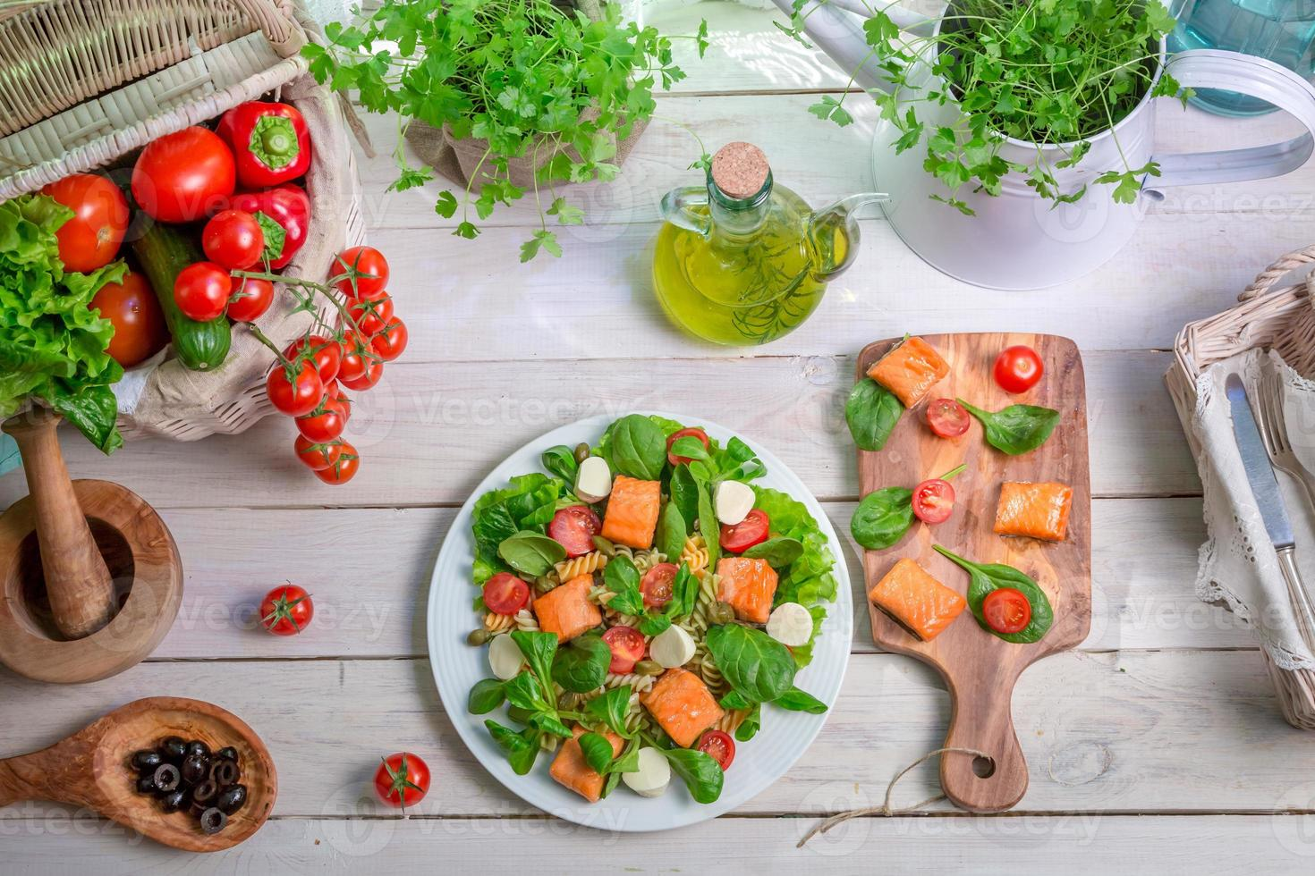 Healthy salad with fresh vegetables and salmon photo
