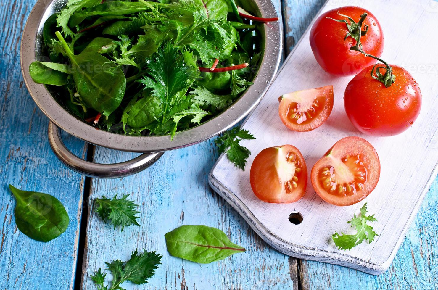 Tomatoes and green lettuce photo