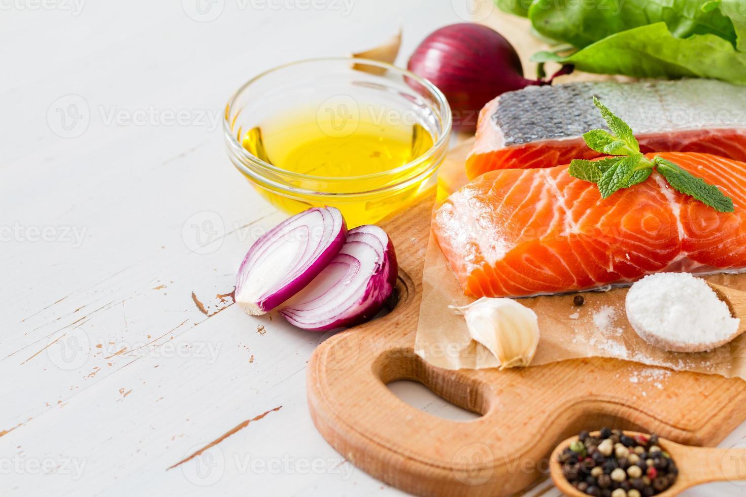 Salmon fillet with spinach, salt, pepper, garlic, oil photo