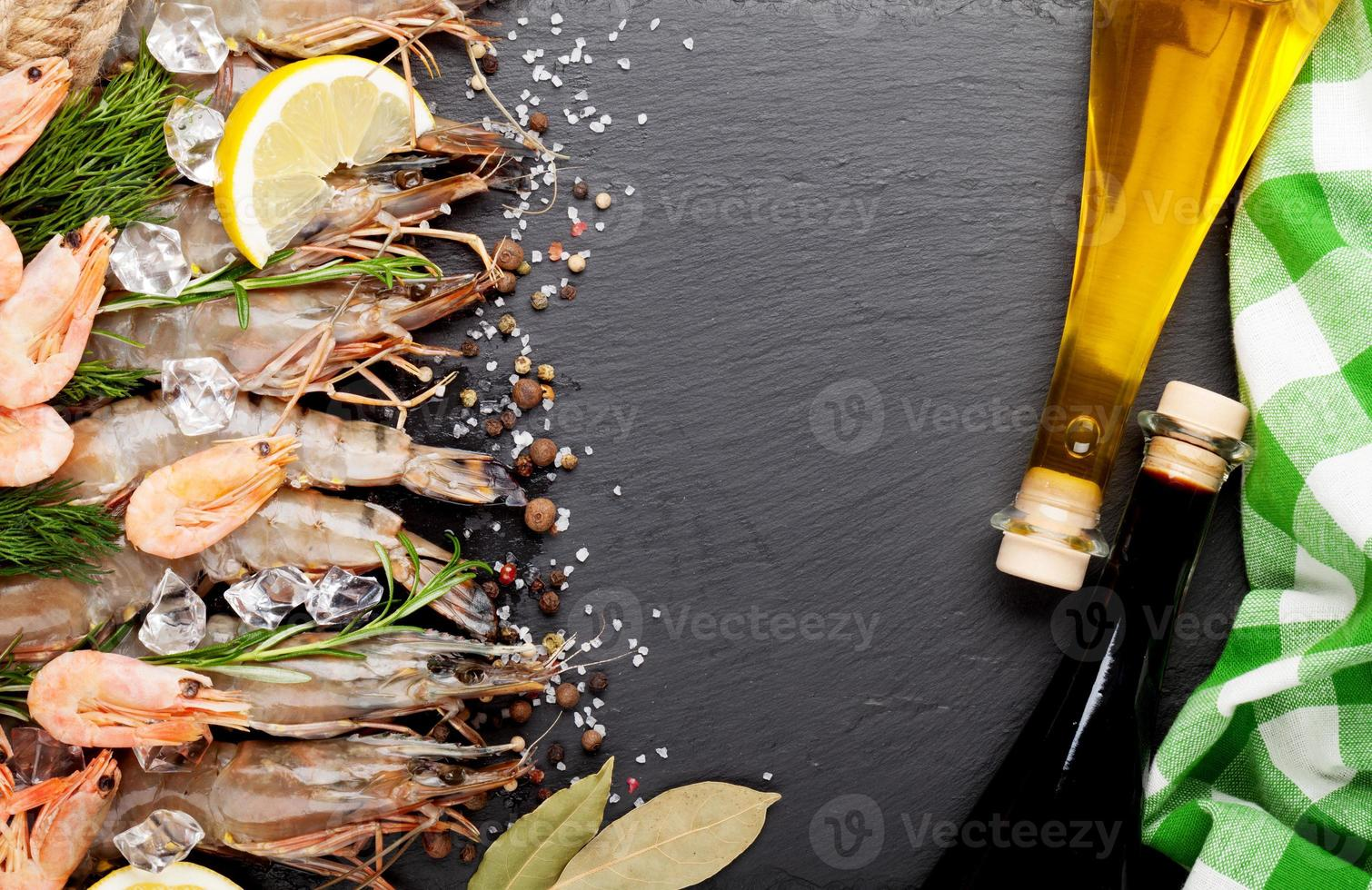 Fresh prawns with spices and condiments photo