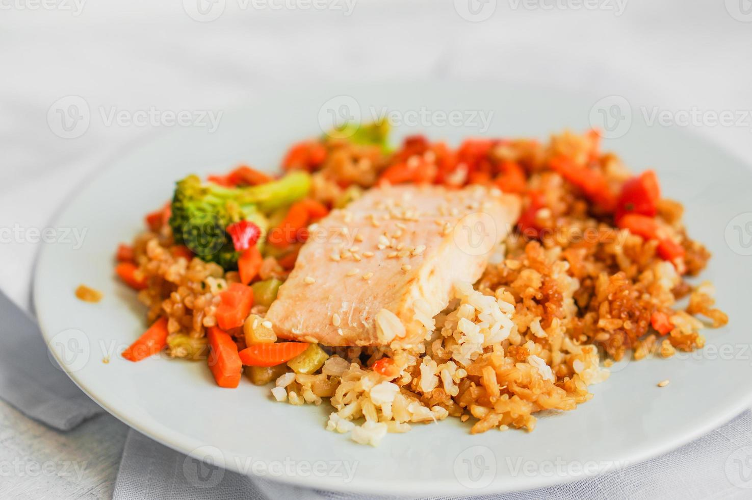 Grilled salmon with quinoa and vegetables photo