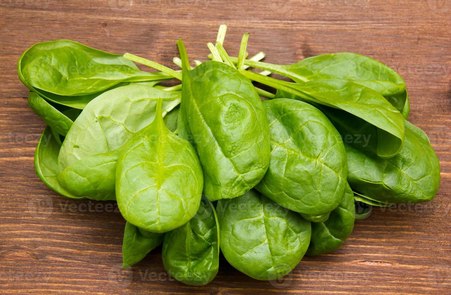Fresh spinach leaves on wood from above photo