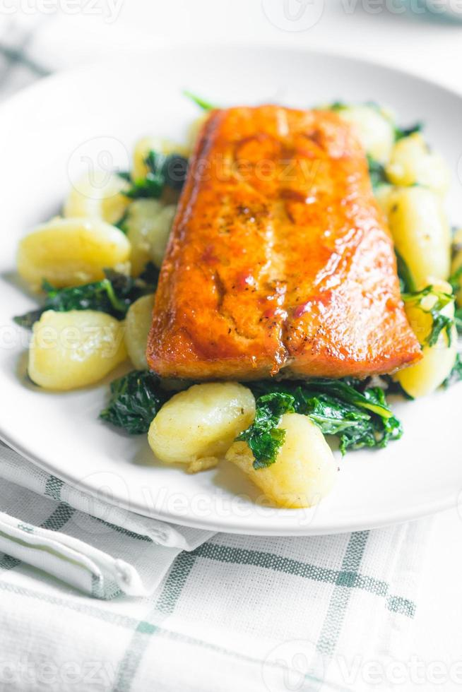 Grilled salmon with gnocchi and greens photo