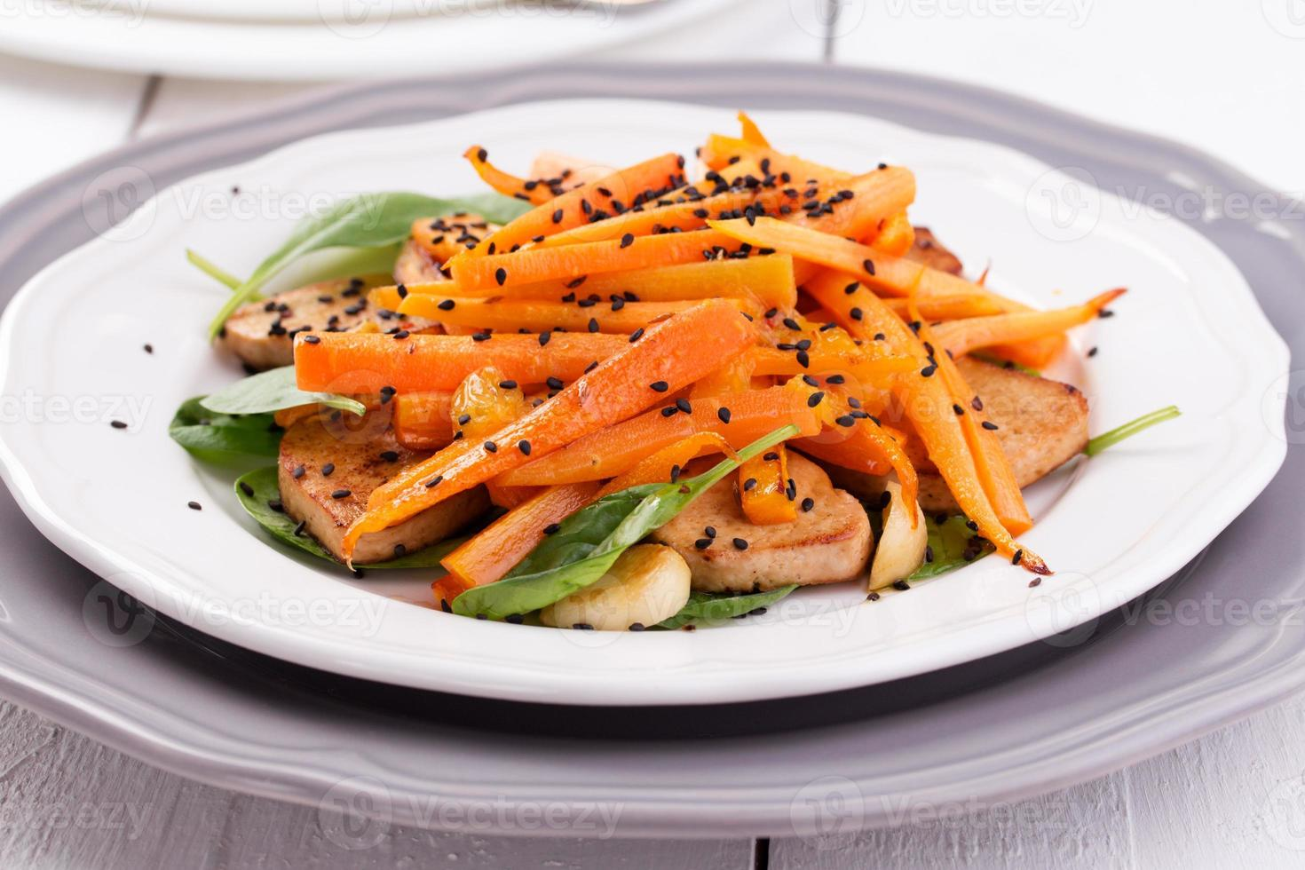 Tofu salad with carrots, spinach and sesame photo