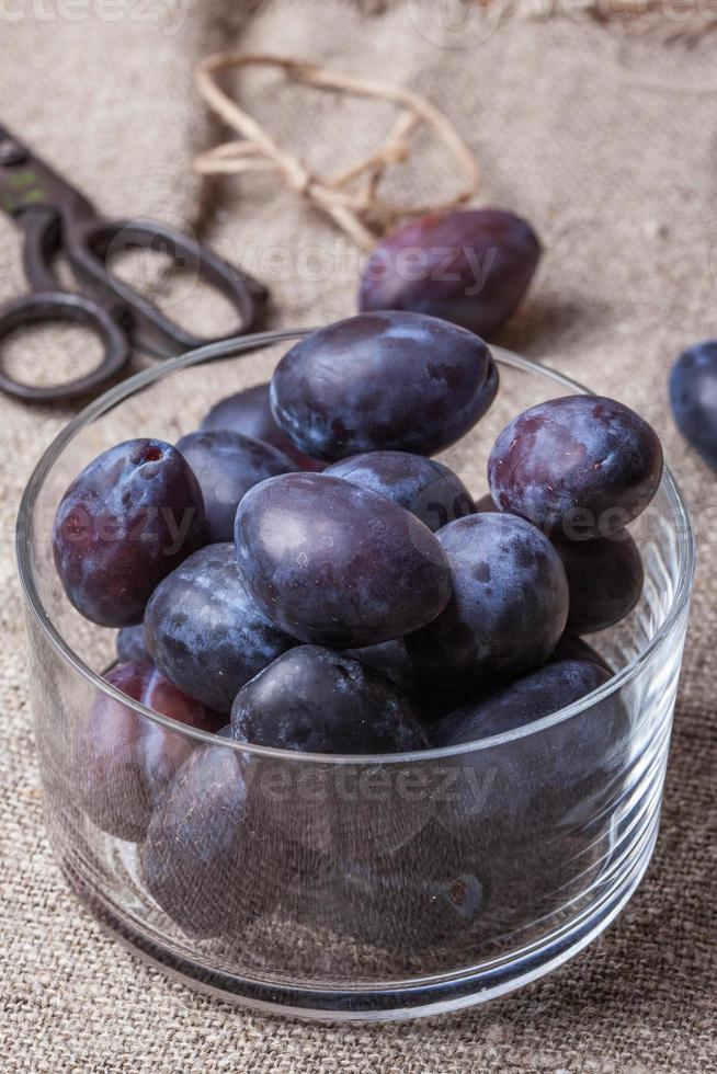 Plums in a glass bowl. photo