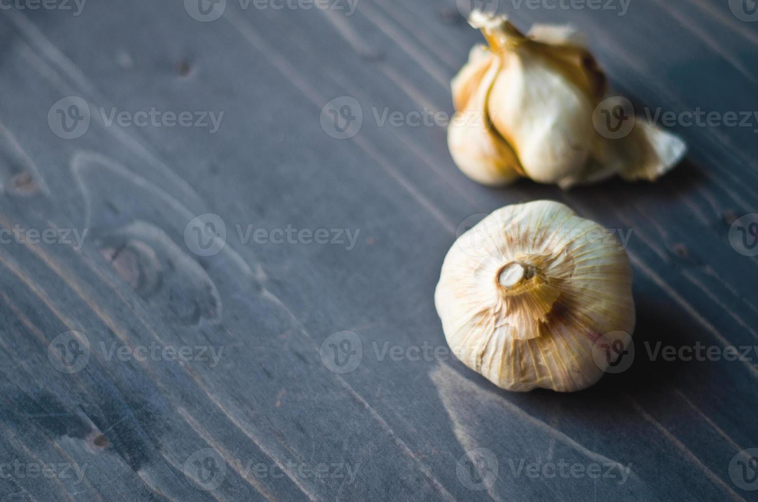 Garlic on woodboard photo