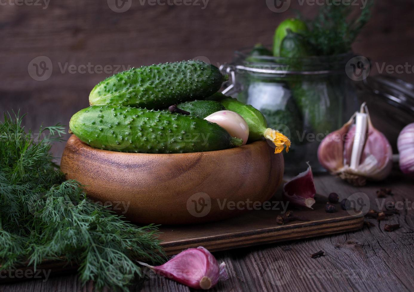 fresh cucumbers on wooden table photo
