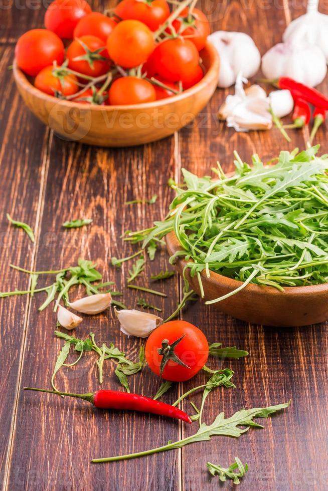 Tomatoes, arugula, pepper, garlic photo