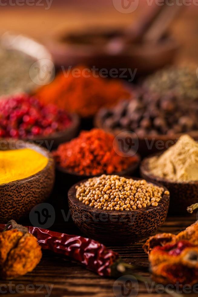Wooden table of colorful spices photo
