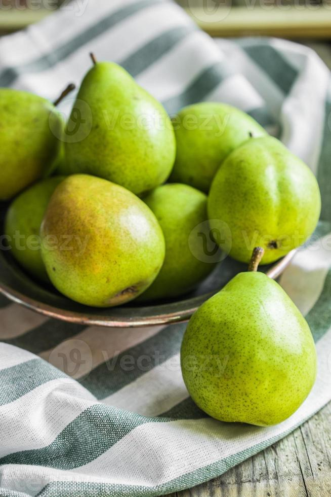 Fruits and vegetables on rustic background photo