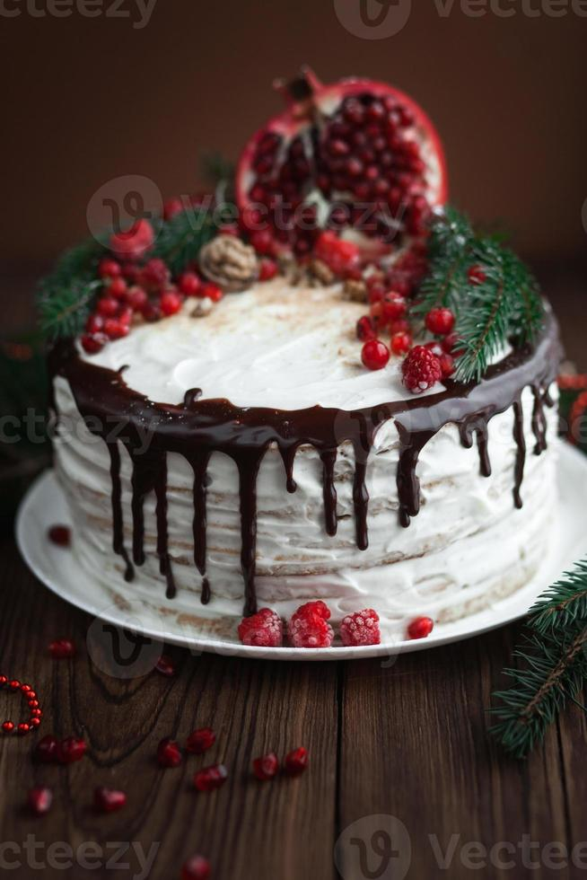 Delicious cake with cream and chocolate photo