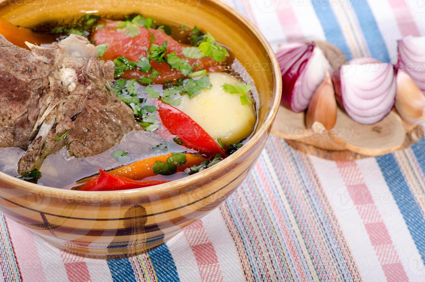 soup shurpa - traditional oriental dish with lamb photo