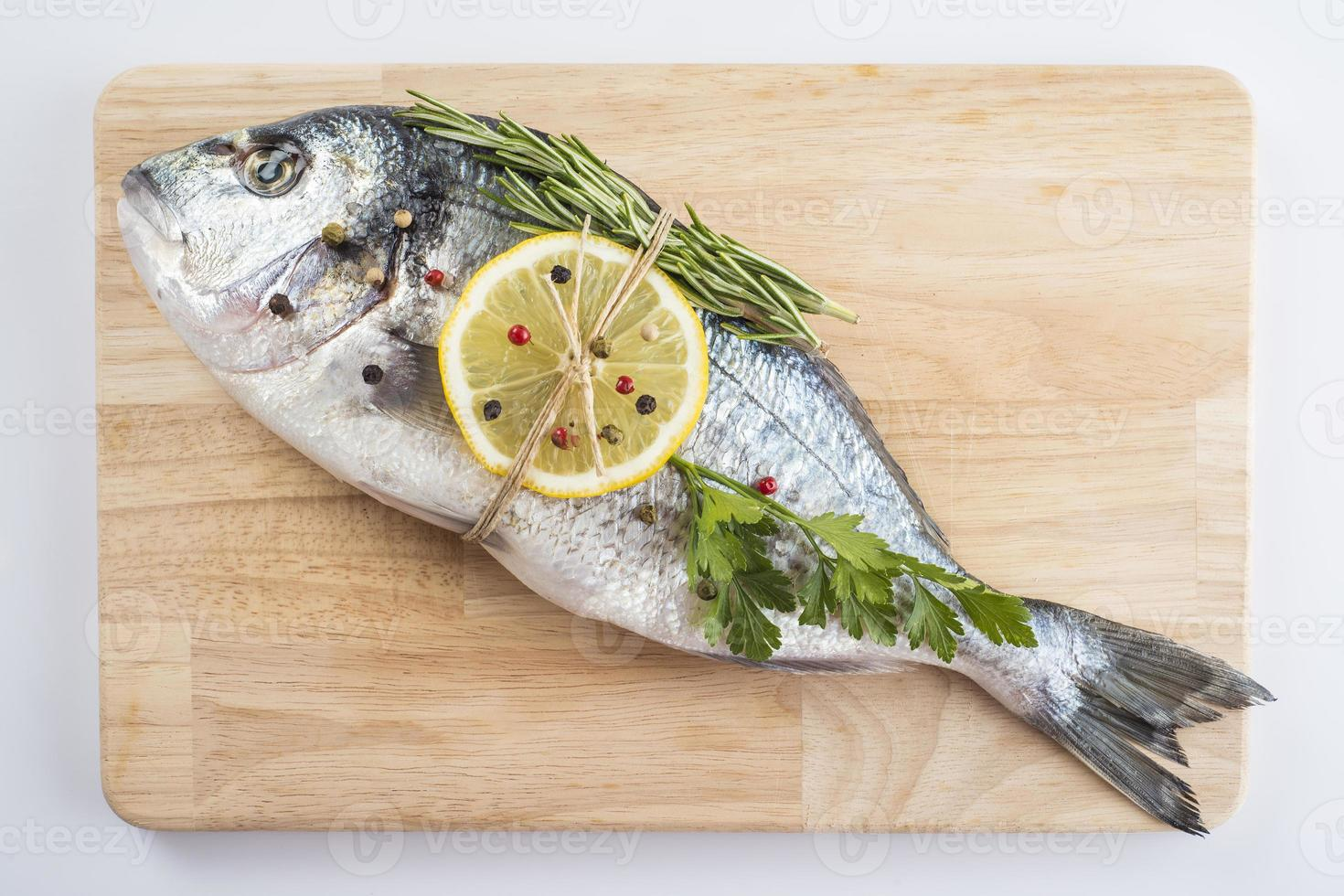Gilt-head sea bream with spices and herbs photo