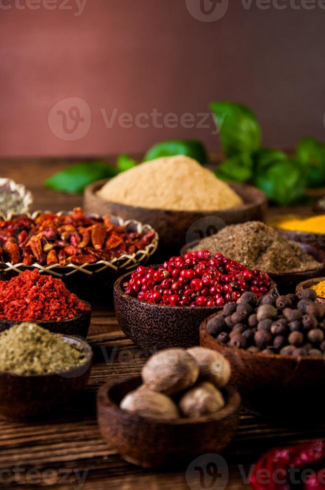 Spices in wooden Indonesian bowls photo