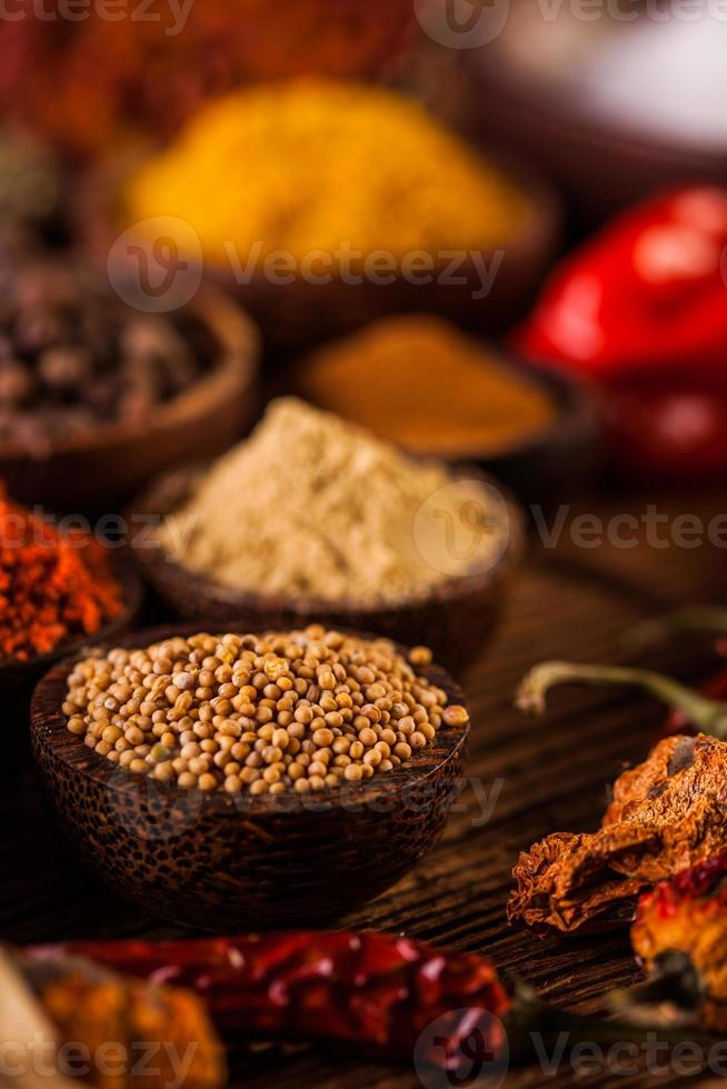 Plenty of traditional Asian spices in wooden bowls photo