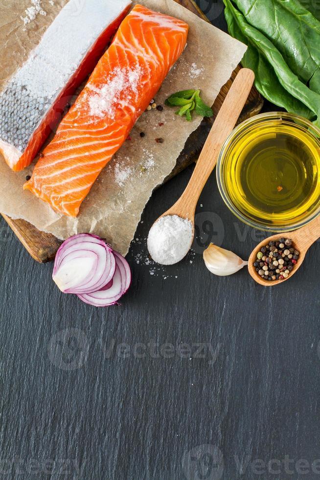 Salmon fillet with spinach salt, pepper, garlic, oil photo