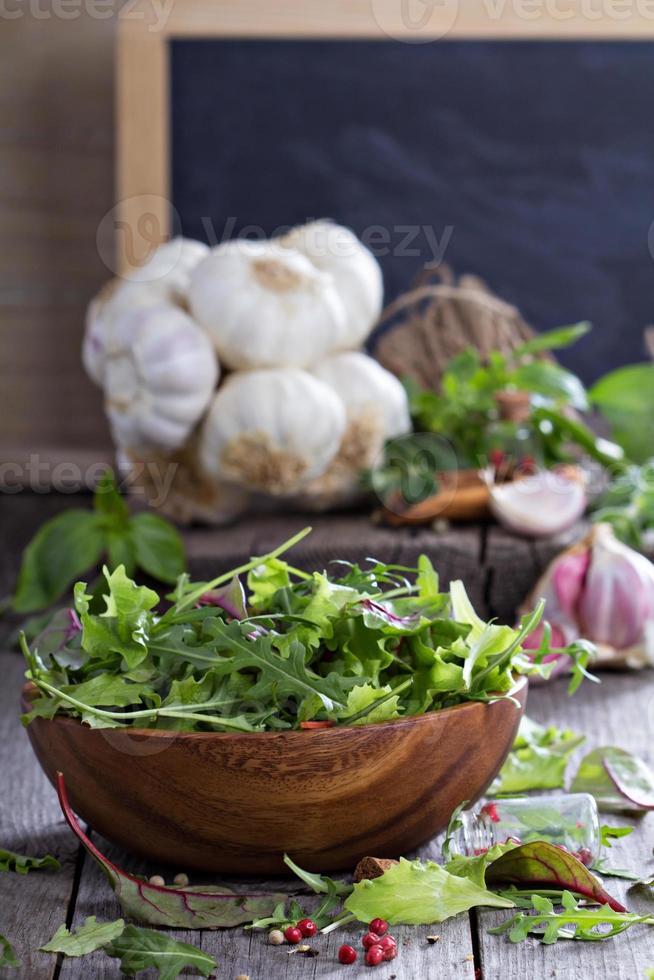 Green salad leaves in a wooden bowl photo