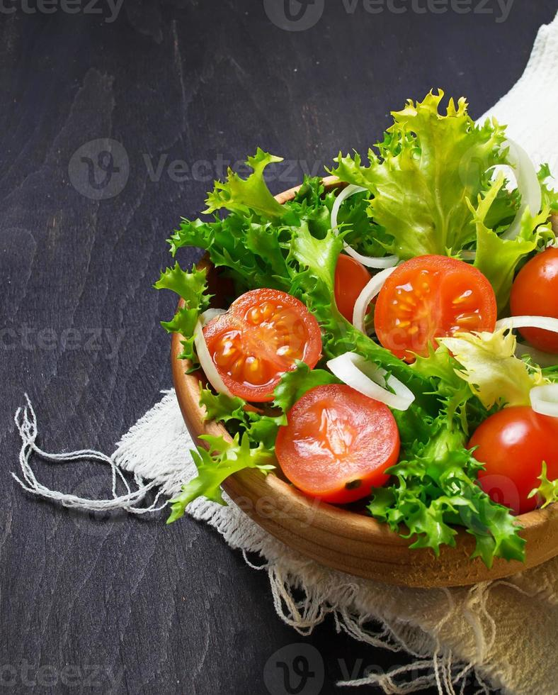 Fresh salad with tomato, frisee and onion photo