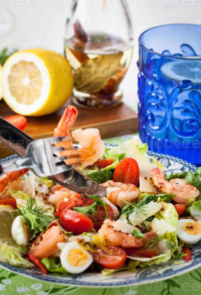 Fresh shrimps, eggs and vegetables salad photo