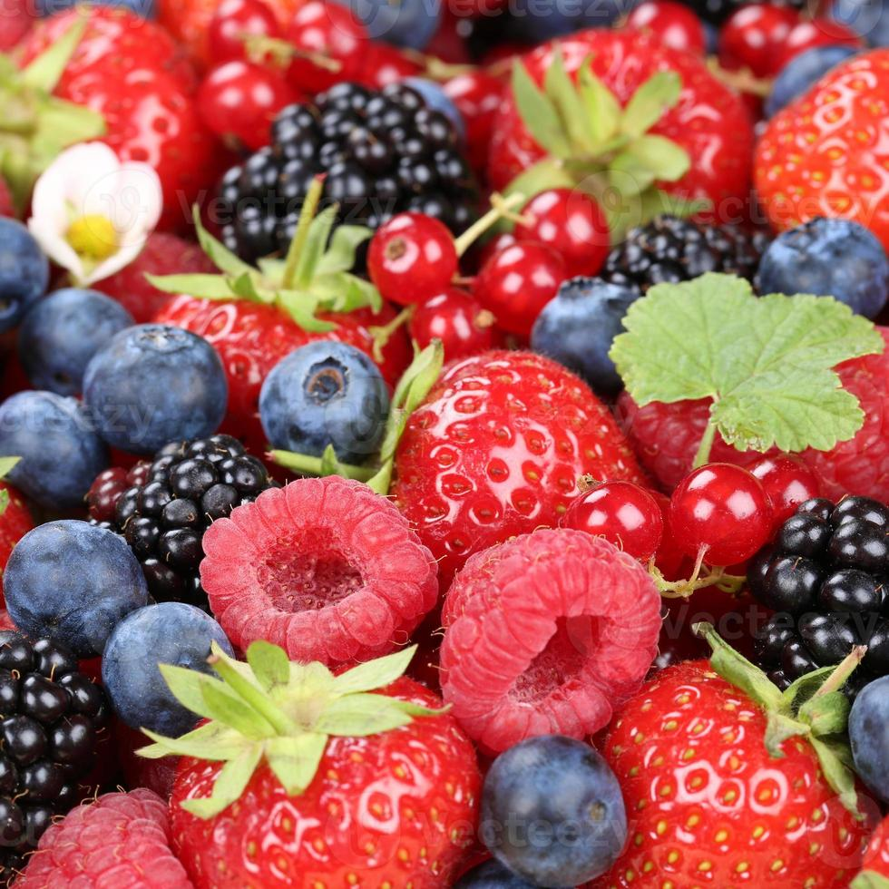 Berry fruits in summer with strawberries, blueberries and raspberries photo