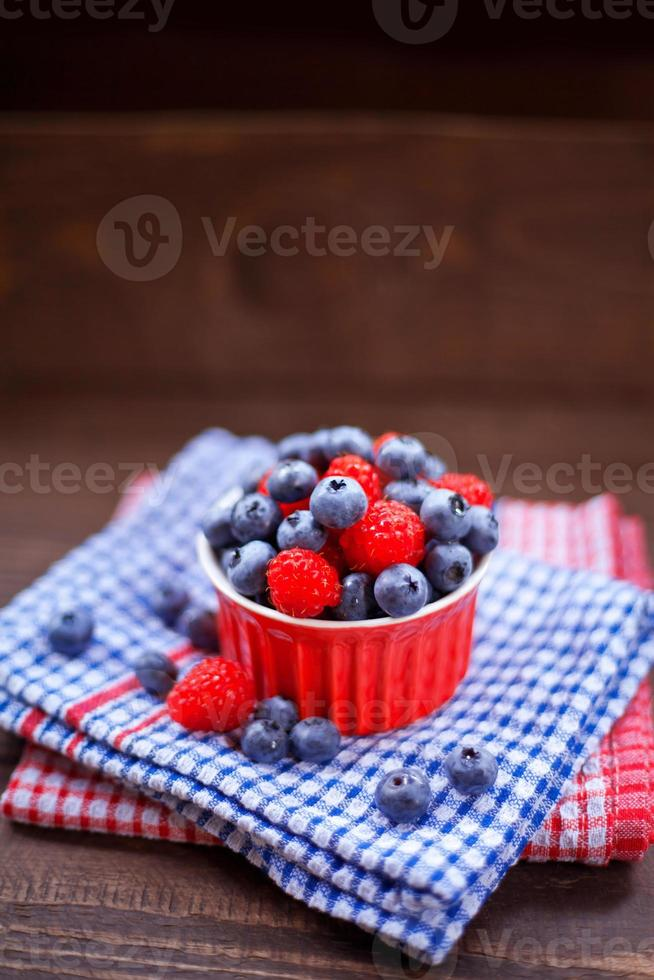Raspberries and blueberries fruits. photo