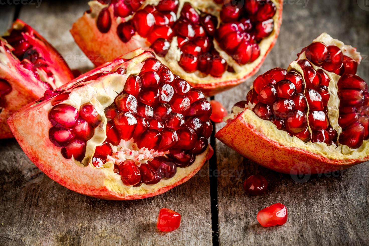 ruby pomegranate grains closeup on a table photo