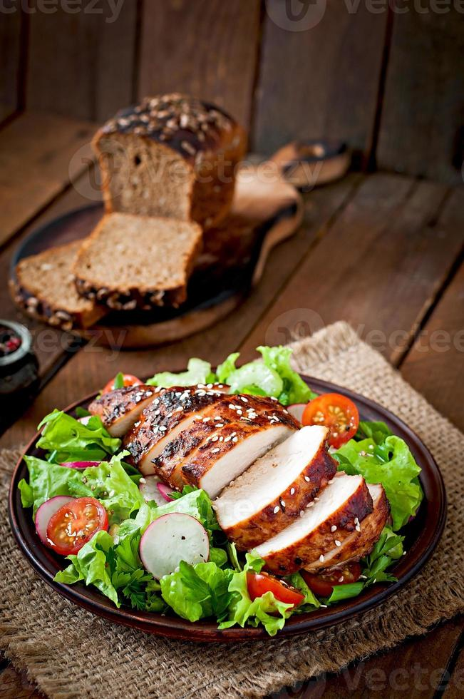 Fresh vegetable salad with grilled chicken breast photo
